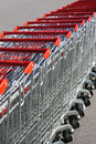Shopping carts in rows a string of outdoors Stock Image