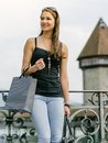 Shopping in the city photo of a beautiful young woman an old european holding bags Stock Photos