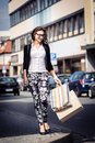 Shopping in the city young woman Royalty Free Stock Photos