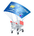 Shopping concept with credit card parachute and cart Stock Photos