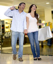 Shopping couple holding bags laughing mall Stock Photography