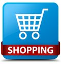 Shopping cyan blue square button red ribbon in middle Royalty Free Stock Photo