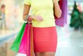 Shopping day female customer carrying colorful bags Royalty Free Stock Photos