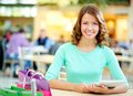 Shopping day portrait of a smiling young woman enjoying her Stock Photography