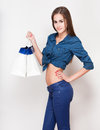 Shopping fun portrait of a gorgeous young brunette holding bags Royalty Free Stock Images