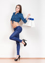 Shopping fun portrait of a gorgeous young brunette holding bags Royalty Free Stock Image