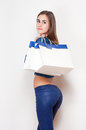 Shopping fun portrait of a gorgeous young brunette holding bags Stock Photos