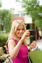 Shopping gal checking image looking at herself Royalty Free Stock Photo