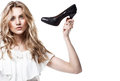 Shopping girl holding a black high heel s Stock Photo