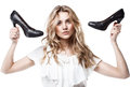 Shopping girl holding a black high heel s Royalty Free Stock Photos
