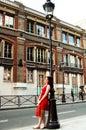 Shopping girl on a Paris street Royalty Free Stock Photos