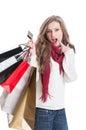 Shopping girl wondering Royalty Free Stock Photo