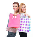 Shopping happy friends two girls with bags isolated on white background Royalty Free Stock Photo