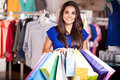 Shopping on a huge sale pretty girl carrying lot of bags after in clothing store Royalty Free Stock Image