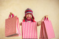 Shopping kid holding christmas bags in hands Stock Image