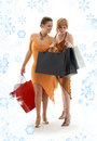 Shopping ladies with snowflakes Royalty Free Stock Photography