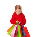 Shopping little girl holding a many shopping bags. Stock Photography