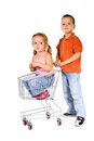 Shopping for a little sister boy pushing cart with girl inside Stock Photos