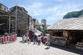 Shopping in mostar bosnia and herzegovina may tourists look at the souvenir shops and local crafts on may bosnia and Royalty Free Stock Image
