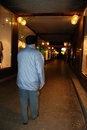 Shopping passage at night lonely walker in the old desolate Royalty Free Stock Photography