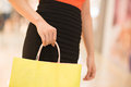 Shopping pastime close up of a female hand holding a bag Royalty Free Stock Photo