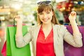 Shopping pleasure portrait of a girl with colorful bags looking at camera Stock Photography