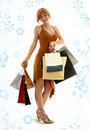 Shopping redhead with snowflakes Stock Photos