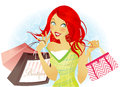 Shopping spree happy redhead woman holding bags Royalty Free Stock Photography