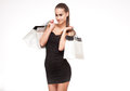 Shopping time portrait of a slender young beauty holding white bags Royalty Free Stock Photography