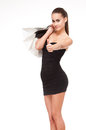 Shopping time portrait of a slender young beauty holding white bags Stock Photo