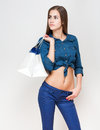 Shopping time portrait of a slender young beauty holding white bags Stock Photography