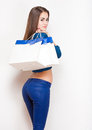 Shopping time portrait of a slender young beauty holding white bags Stock Photos