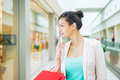 Shopping time young beautiful woman enjoying using cell phone Stock Images