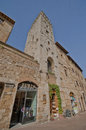 Shopping in toscana along the main street of san gimignano italy Royalty Free Stock Images