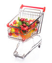 Shopping trolley with fruits isolated on white Royalty Free Stock Photography