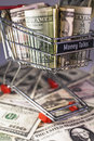 Shopping trolley full dollar bill greenback Stock Photos