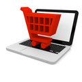 Shopping trolley on laptop Stock Photography