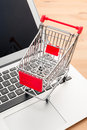 Shopping trolley with laptop computer Royalty Free Stock Image
