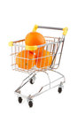 Shopping trolley and oranges Stock Photography