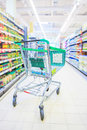 Shopping trolley with some groceries in supermarket Royalty Free Stock Photos