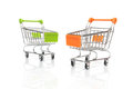 Shopping two carts on white background with reflections Stock Photos