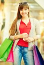 After shopping vertical shot of a happy girl carrying her purchases Stock Photography