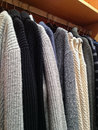 Shopping for winter - warm sweaters for sale Royalty Free Stock Image