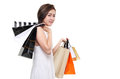 Shopping woman asian happy smiling holding shopping bags isolated on white background lovely fresh young female model Royalty Free Stock Image