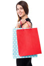 Shopping woman carrying bags fun loving female with vibrant Royalty Free Stock Images
