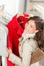 Shopping woman in clothes shop Royalty Free Stock Photo