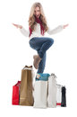 Shopping woman expressing joy and happyness between many bags Stock Images