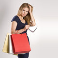 Shopping woman fancy young model with bags posing in studio pretty caucasian blonde female holding sunglasses Stock Photography