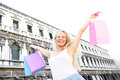 Shopping woman happy holding shopping bags venice with arms raised outstretched beautiful cheerful blonde girl outdoor on piazza Royalty Free Stock Images