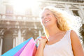 Shopping woman happy holding shopping bags venice with arms raised outstretched beautiful cheerful blonde girl outdoor on piazza Royalty Free Stock Photos